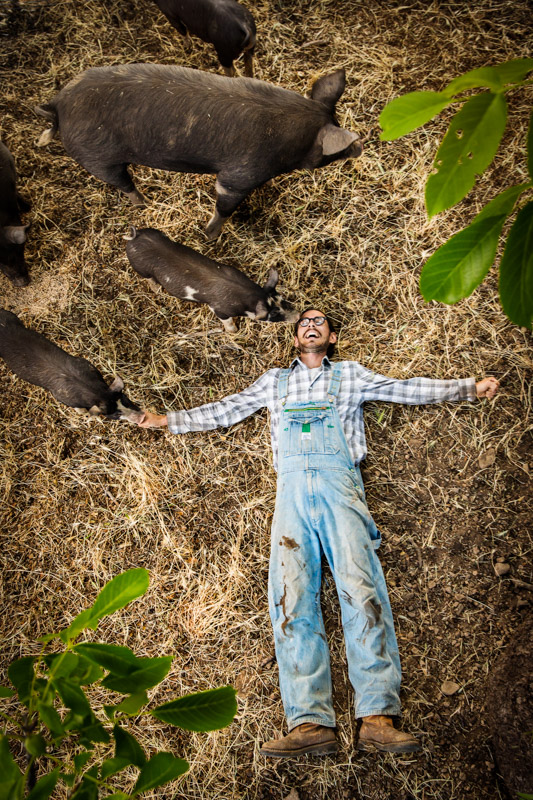 Jake Francis and his pigs. Photo courtesy of Brian Hodges