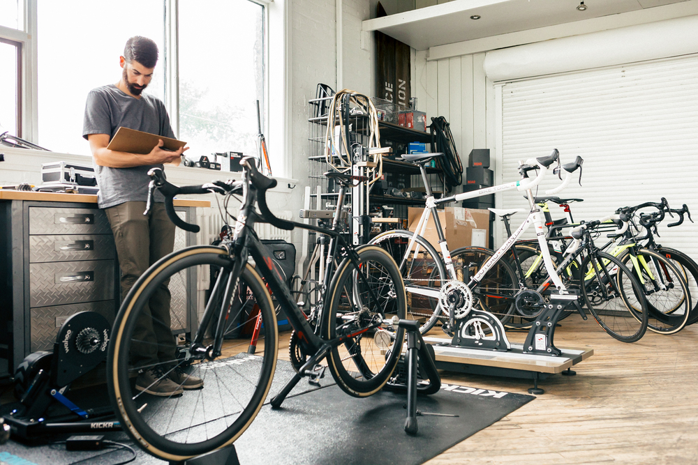 Master blacksmith and show owner, Mike Yakubowicz, reviews the fit and geometry details of my current and past bikes