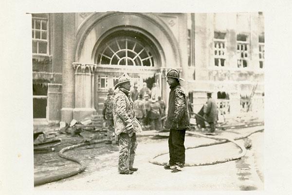 Lafayette School Fire - Salt Lake City, UT, 1922. Firemen talking in front of the burned out Lafayette School.