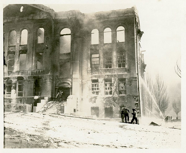 Lafayette School Fire - Salt Lake City, UT, 1922. It looks like boys playing in front of the school while fireman work in the background, but closer inspection shows they are wearing firemen hats.