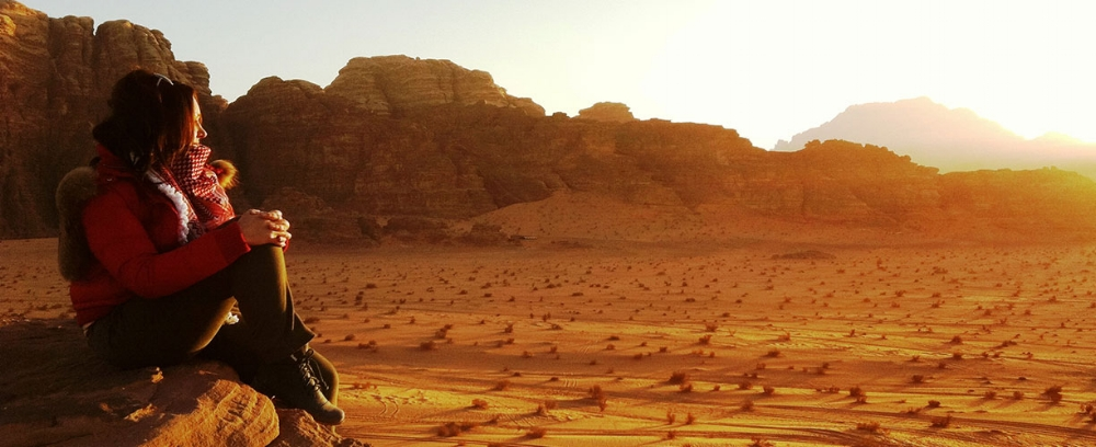 Asia-Jordan-Wadi-Rum-Woman-Watching-Sunset.jpg
