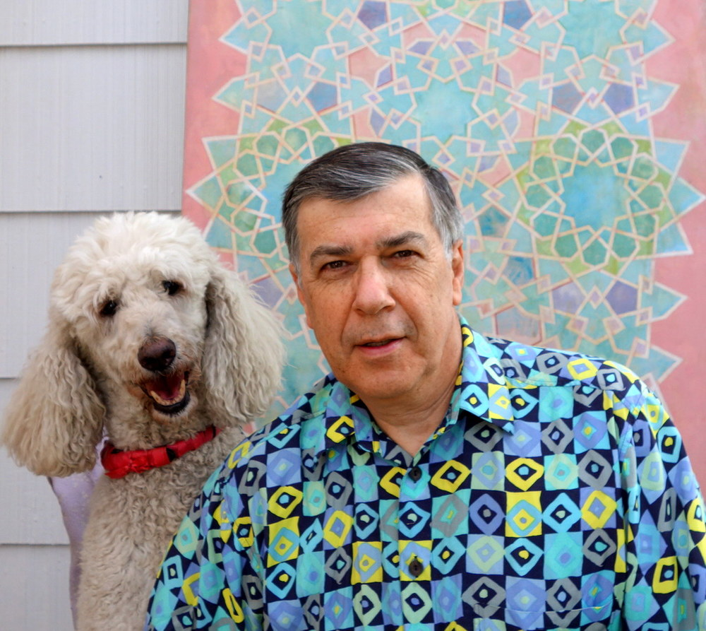 Behind me is a very geometric painting and I am wearing a shirt with a much simpler but what I find pretty geometric pattern.   Interestingly, the shirt comes from Europe.  2/2015.