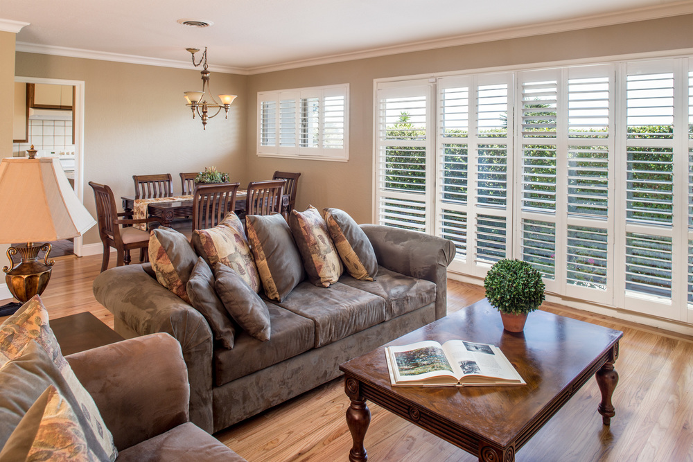 3- Living room dining room combo with newly refinished hardwood floors and plantation shutters.jpg