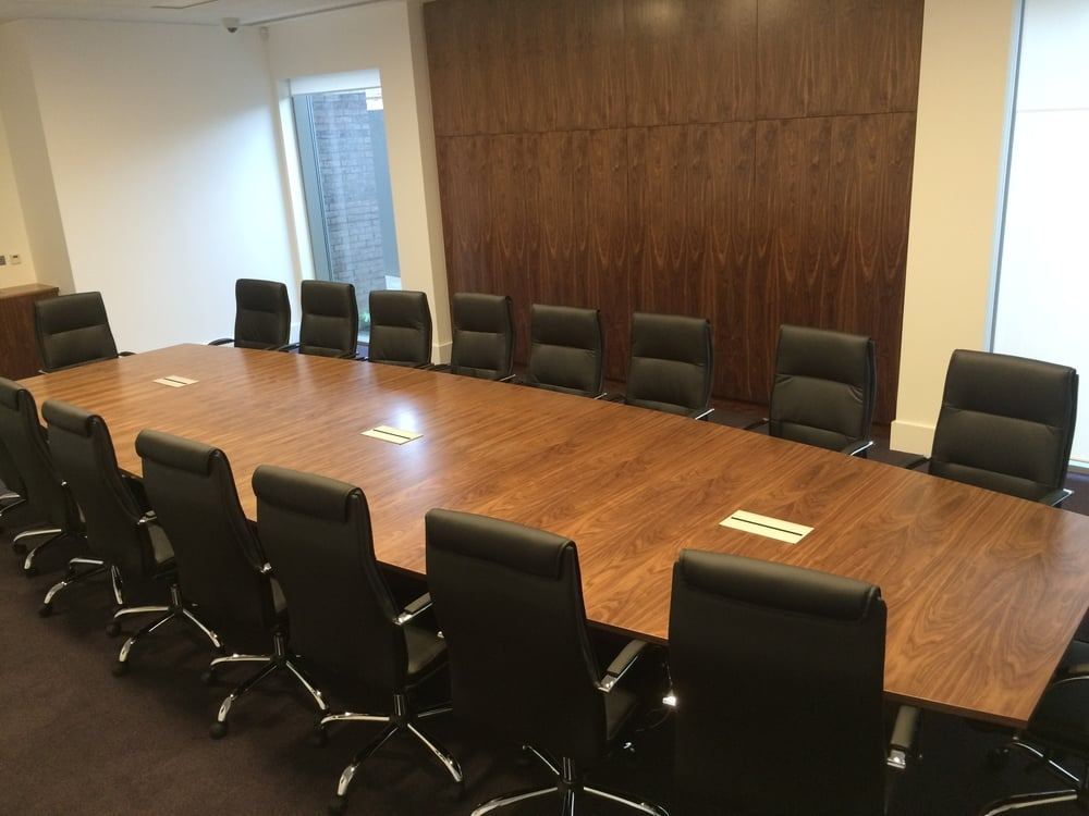 The executive boardroom was a prime opportunity to bring a little glamour into the office with the classic look of walnut teamed with modern functionality in both easy access power supplies and wall storage.