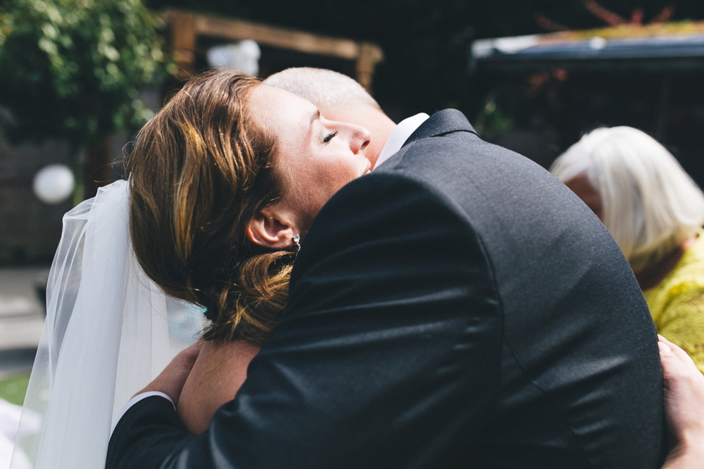 Bride and groom hugging after first look in the hague the nether