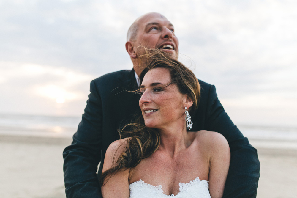 Loveshoot on the beach in the hague by weddingphotographer