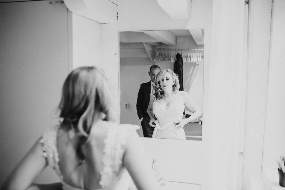 groom getting ready in suite 28