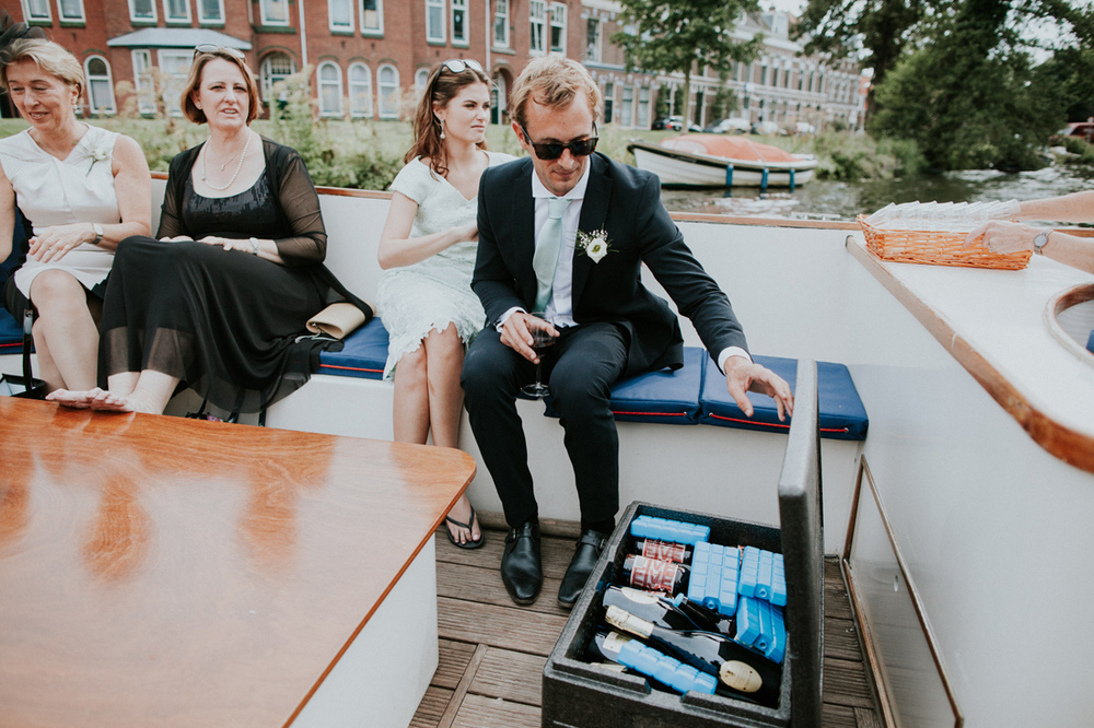 champagne and snacks on a boat in leiden at a wedding