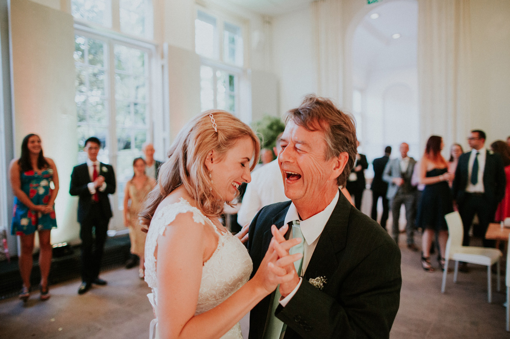father and bride dancing at orangerie