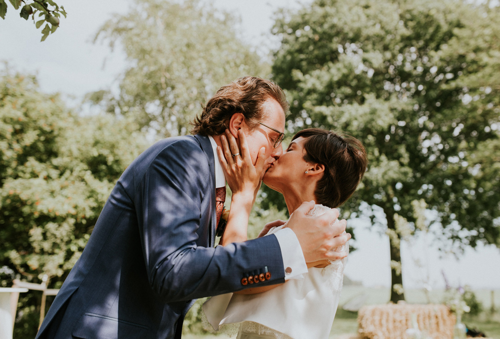 first kiss of the bride at a vintage wedding in friesland