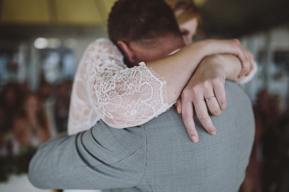 Bride and groom hugging emotional after saying yes