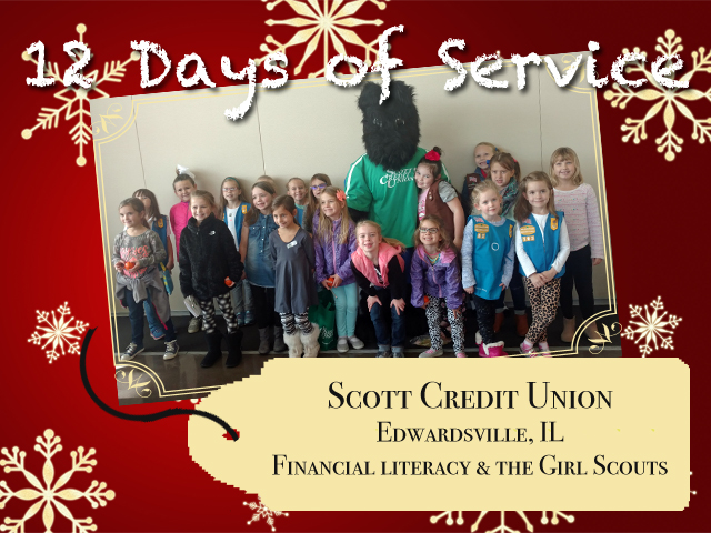 "Scott Credit Union's Big Barkers Kidz Club mascot, Scotty, with participants of the ""Money Wise"" workshop."