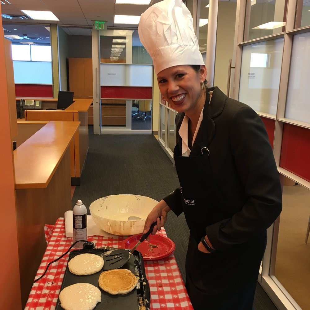 Paris Chevalier, Chief Marketing Officer of Xceed Financial Credit Union, making pancakes on Associate Appreciation Day.