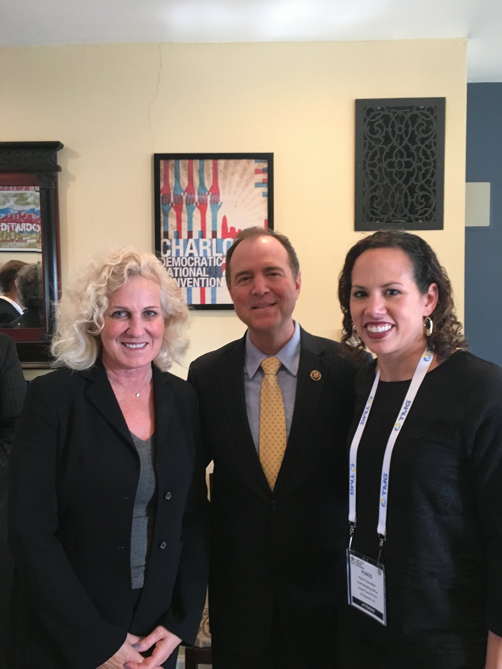 Chevalier hiking the hill at GAC with Teresa Freeborn, Xceed's CEO, and Representative Adam Schiff