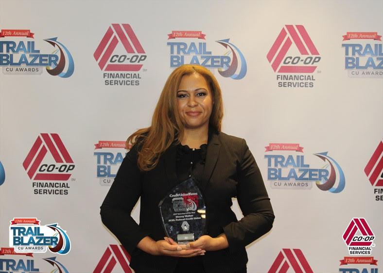 Stacey Walker receiving the CU Times Trailblazer Volunteer of the Year Award