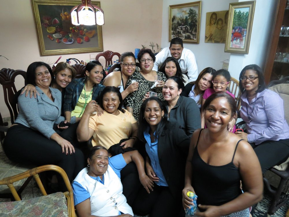 Stacey Walker with her host family and staff of COOP-HERRERA during her welcome dinner while participating in a fellowship under WOCCU's International Credit Union Leadership Program