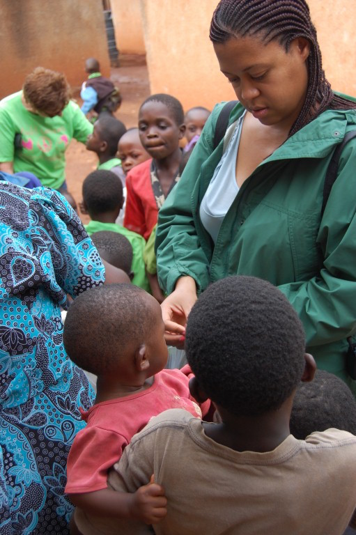 Stacey Walker handing out candy at Busia Orphanage in Kenya during the Global Women's Leadership Network Engagement Program