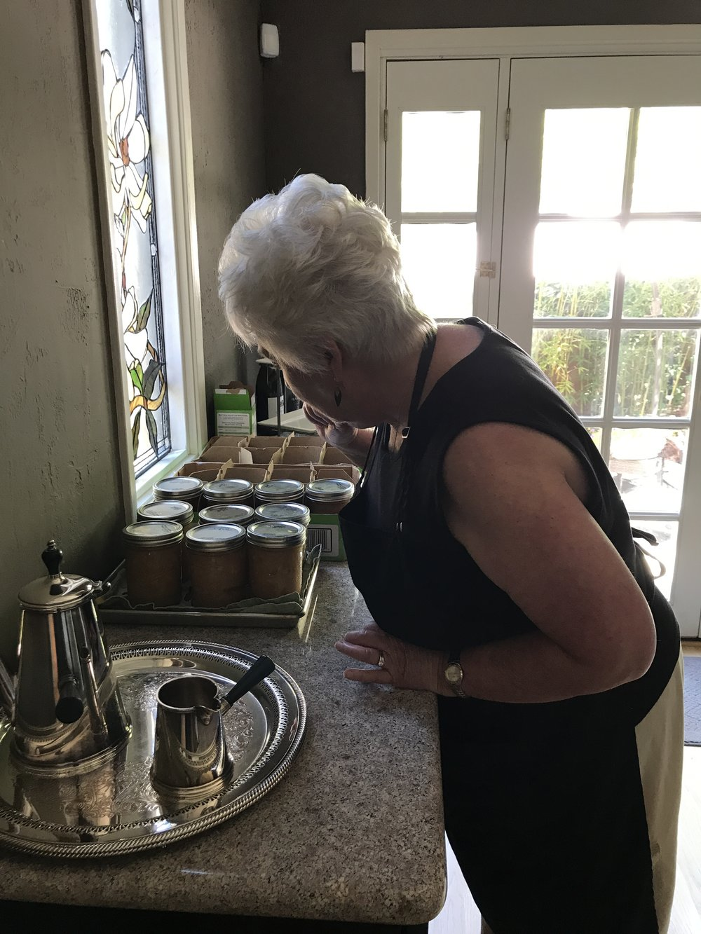 Julie checking our jars. Yum yum yum.