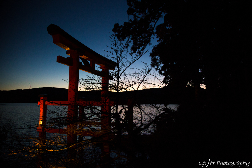 The gate of Hakone Shrine at sunset