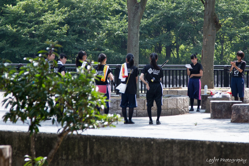 High school band members practicing in the park. Brings back memories of my own secondary school band days