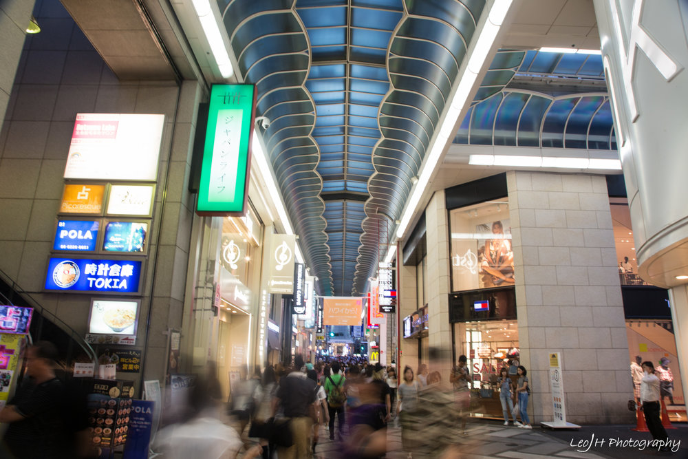 Inside of the shopping street, full of people.