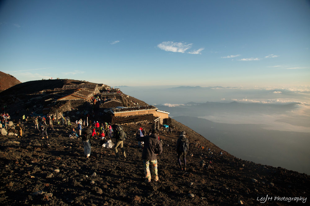 Crowds just hanging around and taking photos at the summit after sunrise.