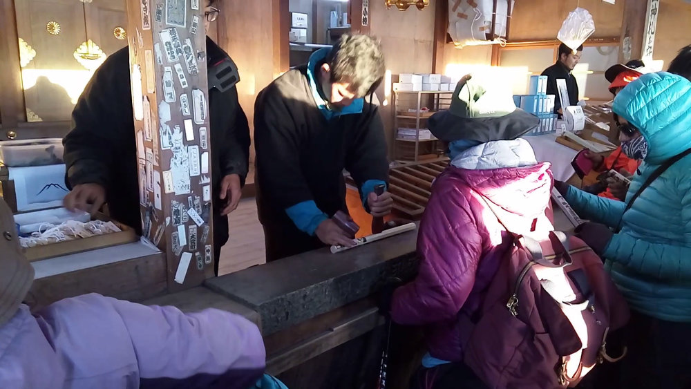 Hikers having their sticks stamped