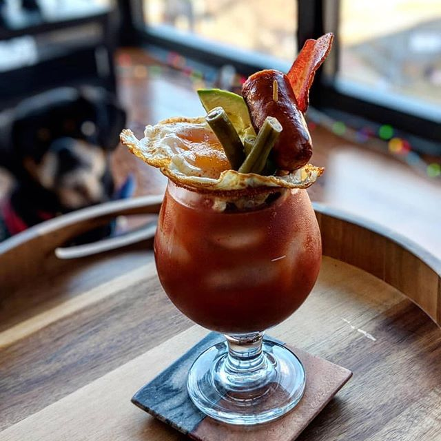 Check out this masterpiece from @toastycheesitz Our Bronc Buster Beans have never had it so good! 📷: @toastycheesitz #bloodymarys #tooprettytodrink #nationalbaconday #perfection👌#putapickleonit