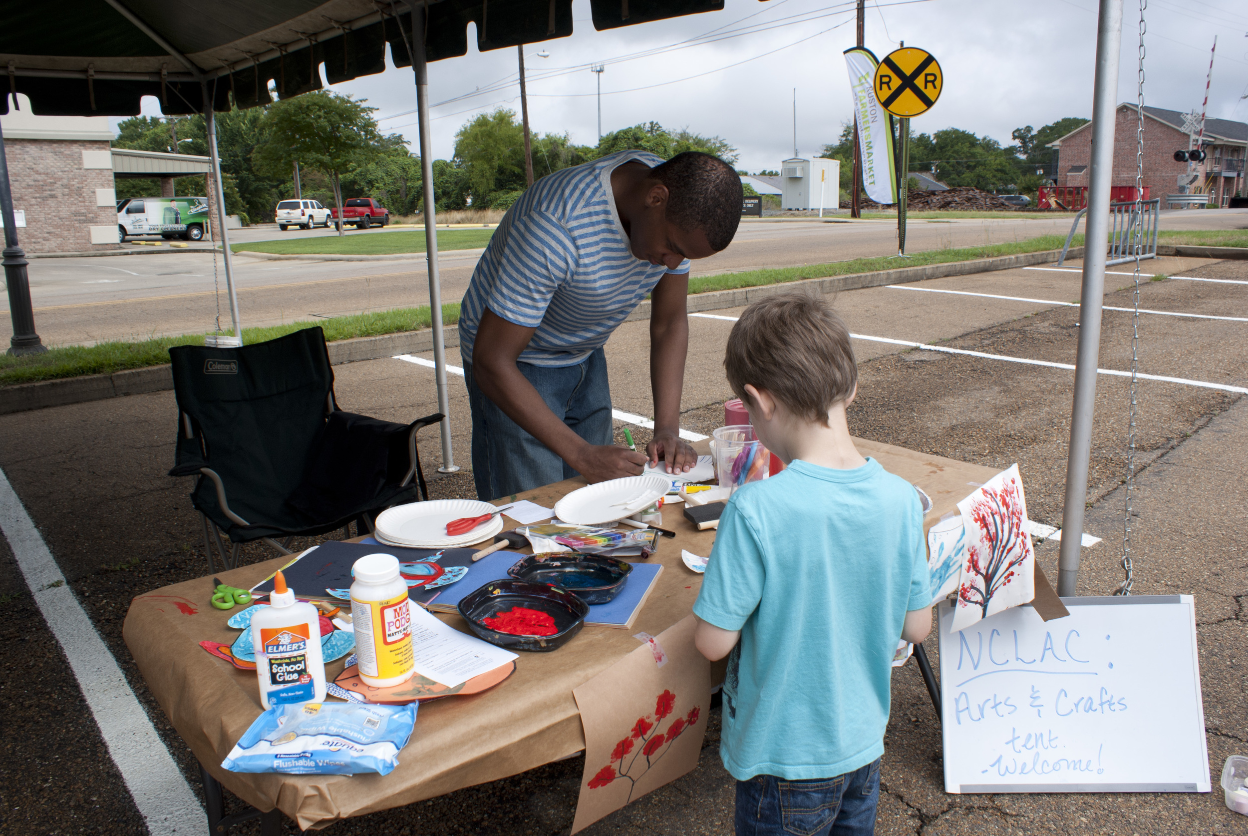 """making something with NCLAC"" at our Ruston Farmers Market booth"
