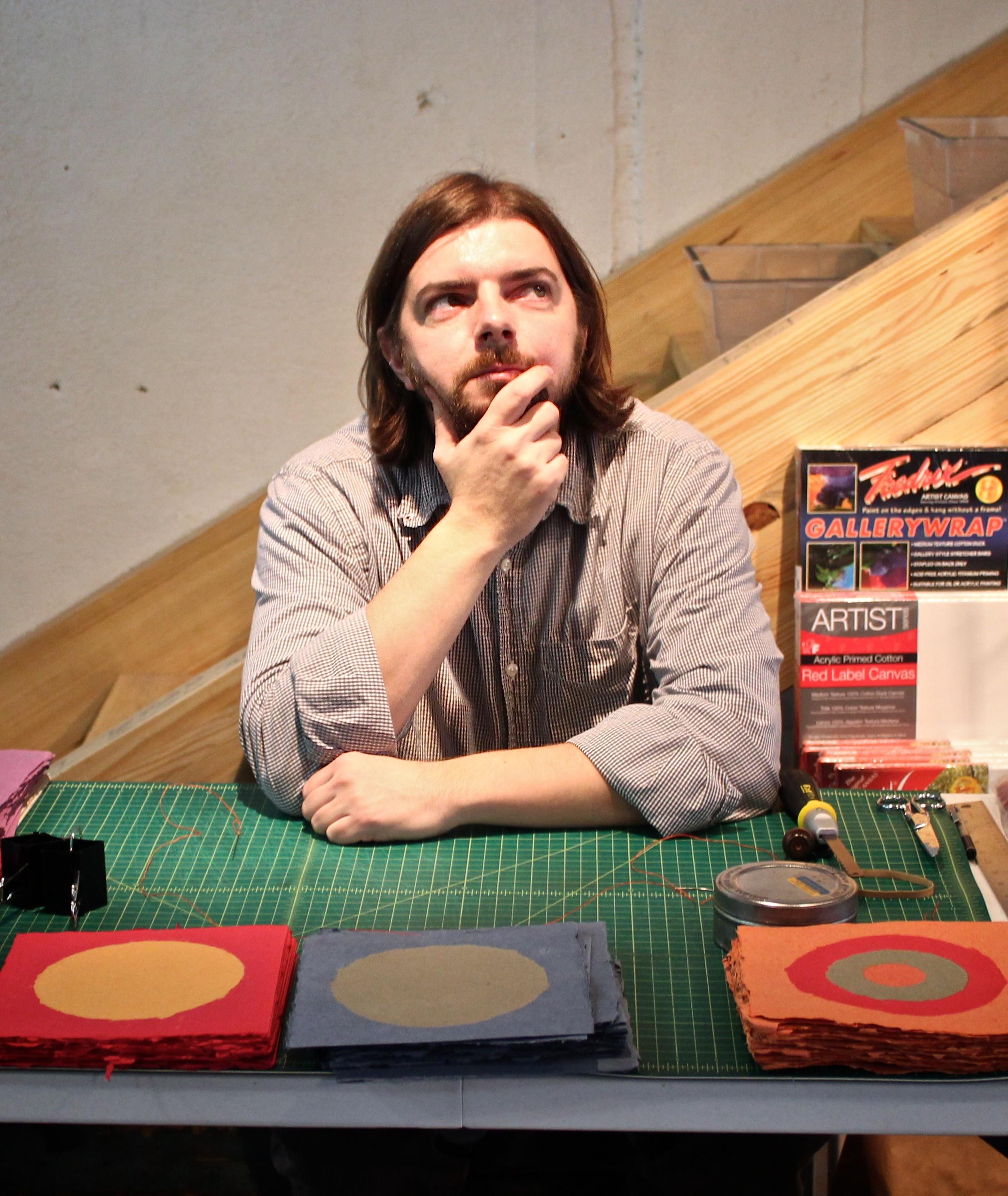 artist Frank Hamrick with handmade books at HAT 2013
