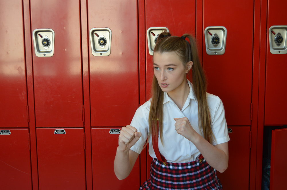 Madelynn Deason, who plays Emi Edwards, strikes her fiercest fighting pose in preparation to battle the Shoguns of her high school