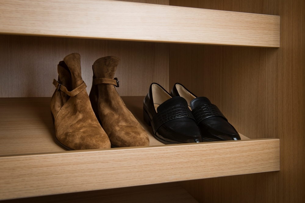 Angled Shoe shelves                                                                                                            Keep your footwear tidy and protected.