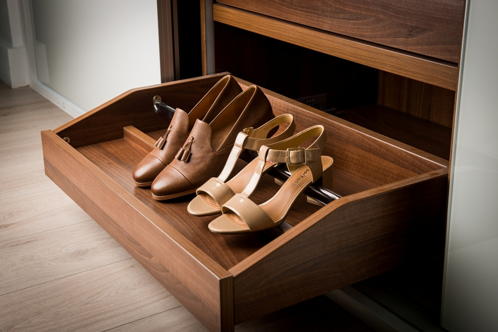 Pullout shoe drawers Designed to take both mens' and womens' shoes, the drawers click back into place when finished with.