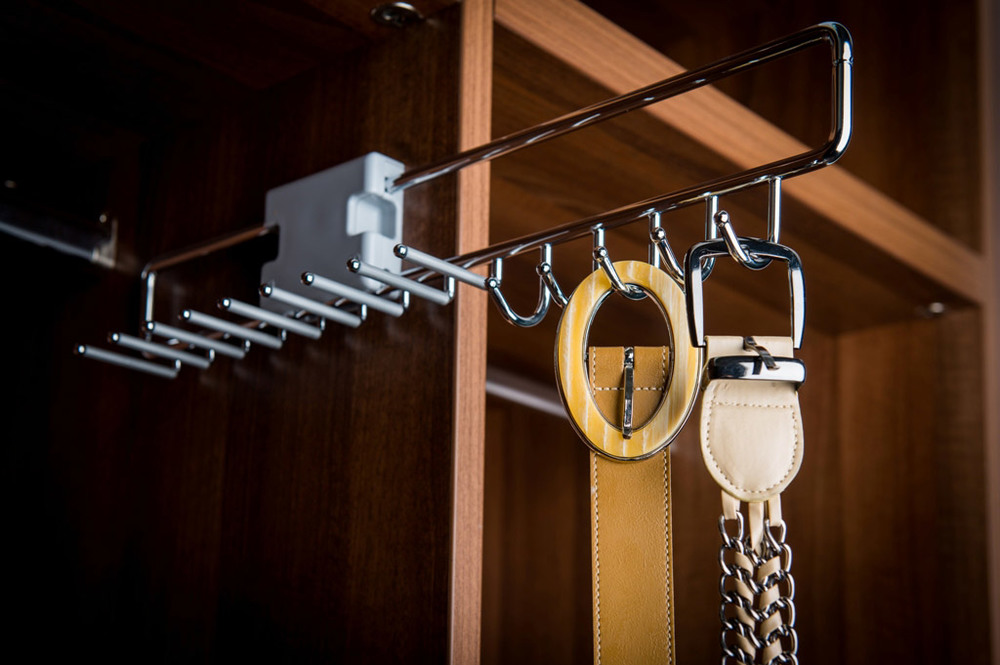Pullout tie & belt rack  Keep your leather in good condition by having it hanging and easy to reach.