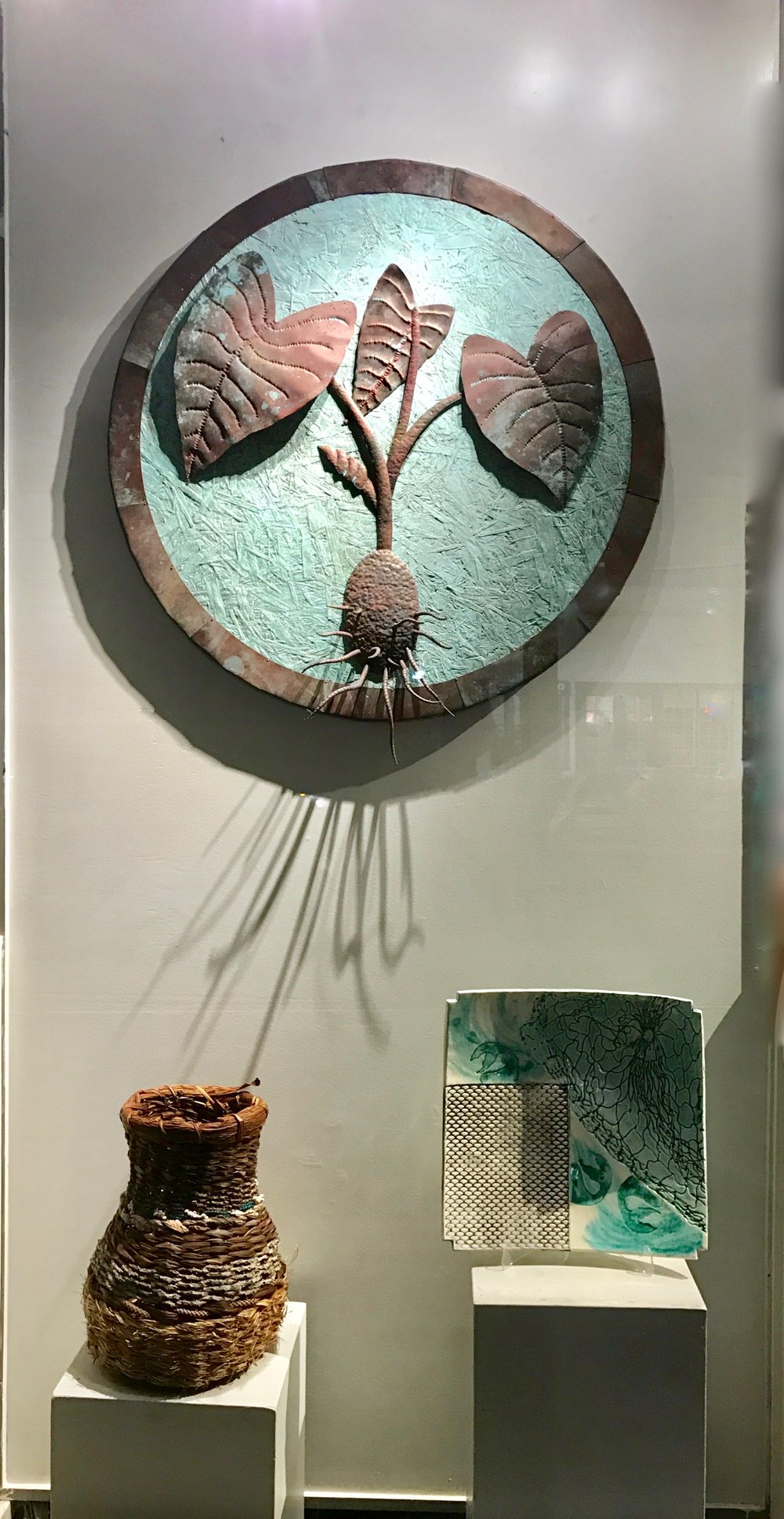 Main piecebehind is by Barclay Hill,  left Fiama, and right Arabella Art Ceramics.  Maui Crafts Guild   2017