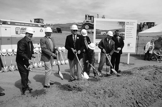 Members of the Board of Directors of Tehachapi Valley Healthcare District toss ceremonial shovelfuls of earth at the official groundbreaking for the new Tehachapi Hospital. From left are Dr. Kim Horowitz, Dr. Sam Conklin, Dr.Gary Olsen, Henry Schaeffer with grandson, Duane Moats and Hospital CFO William Van Noy. (2013)
