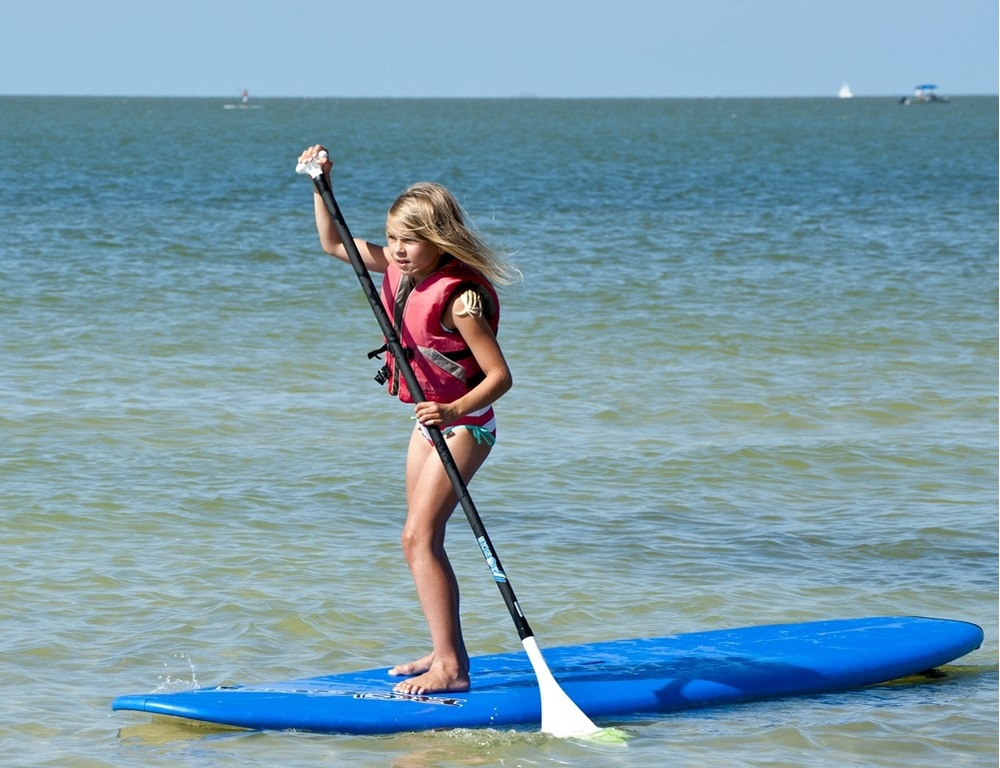 Kacie on paddleboard cropped.jpg