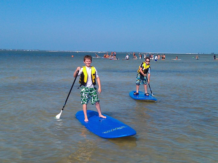 Ben and Trent on paddle boards (1).jpg