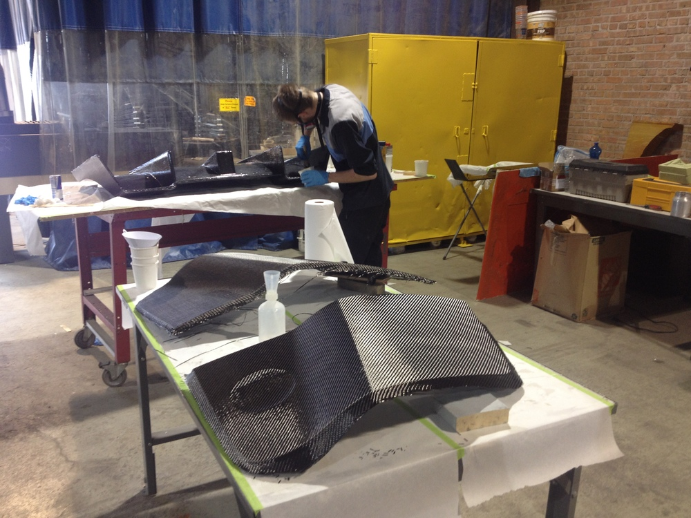 Materials Assistant working on carbon fiber car parts at Fiberworks in Chicago.