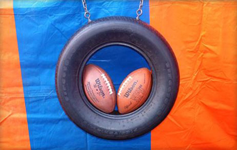 Quarterback Toss Test your aim and spiral in our Quarterback Toss! 2 tickets to play (3 tries)
