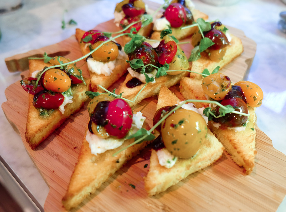 Cherry Tomato Bruschetta:  Basil Marinated Cherry Tomatoes, Burrata,  Olde Hearth  Toasted Challah, Balsamic Gastrique
