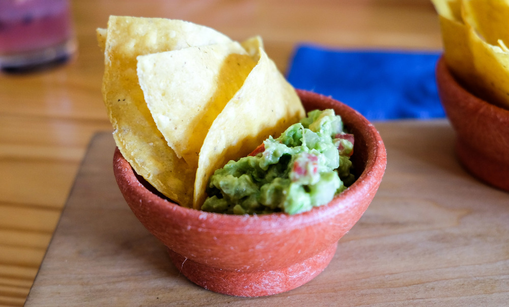 Black Rooster Chips & Guacamole: Avocado, Tomatoes, Onion, Cilantro, Chile Serrano, Lime