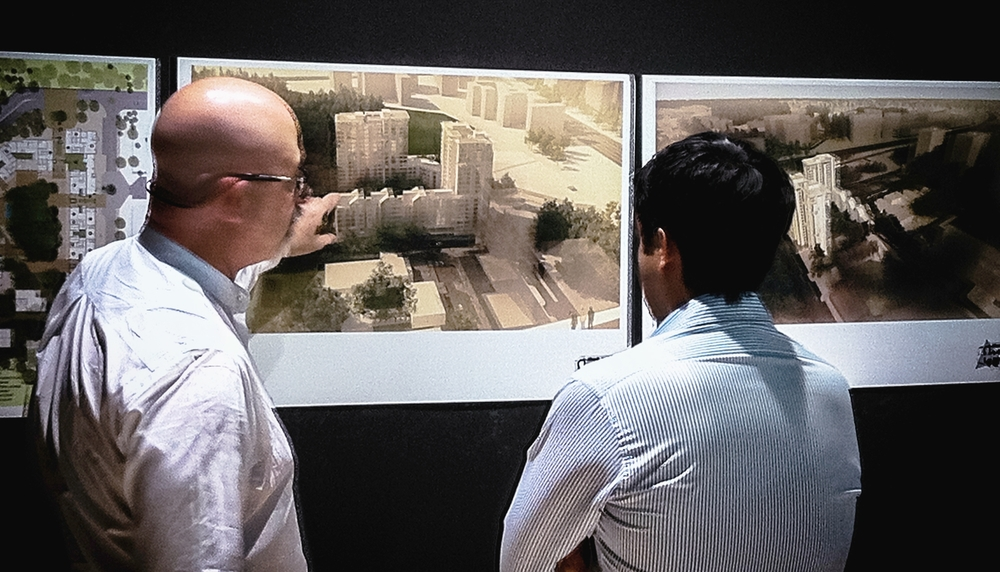 Aaron Schwarz of Plan A Architecture + Design PLLC looking over renderings with a fellow architect.