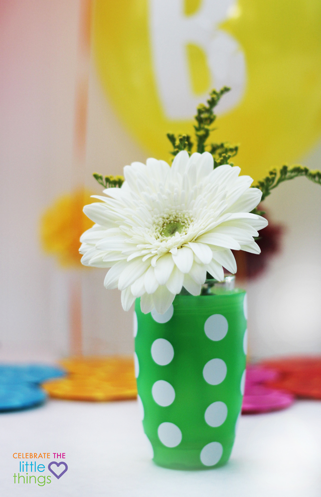 Add dot stickers or vinyl circles to these bright cups and they become fun floral centerpieces.