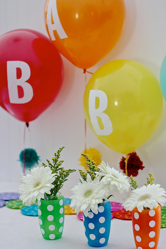 Throwing a baby shower or a party for a new mom? Use toys and gear as a part of the decorations for a bright surprise that a new mom can put right to use!