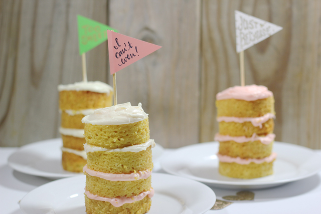 Happy toppers on these Just Because cake let you know you're loved. Use a skewer to poke all the way through the layers and add stability.