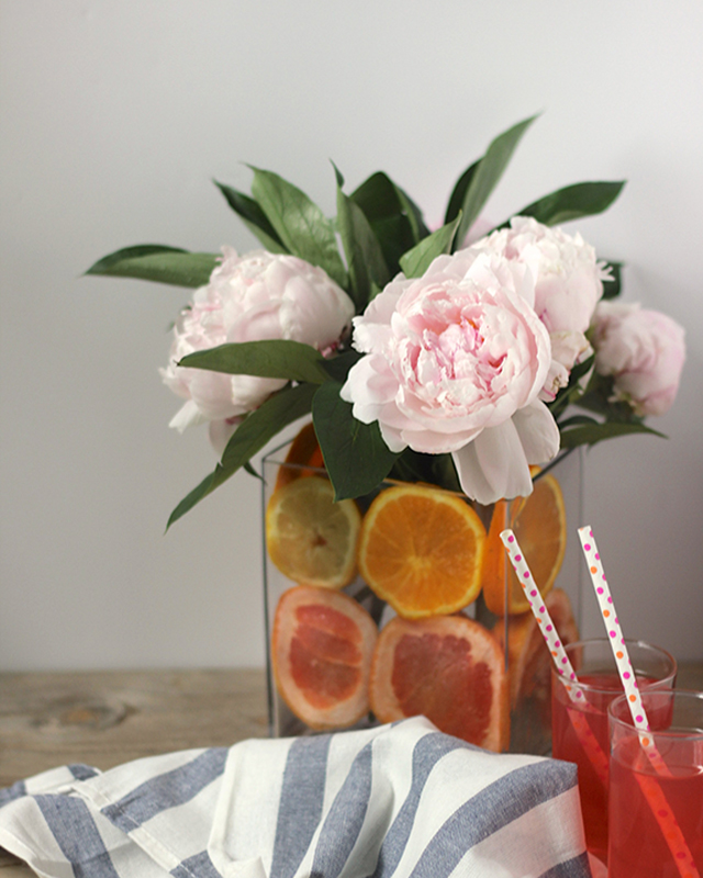 Slices of citrus add the color and the vibrancy to summer's blooms!