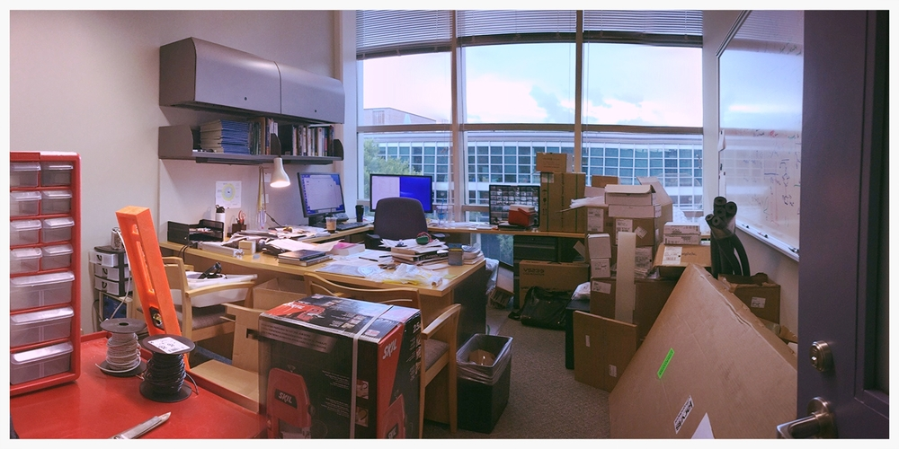 My office, six months in: Full of equipment, parts, and tools. I still remember when everyone remarked at how clean it was.
