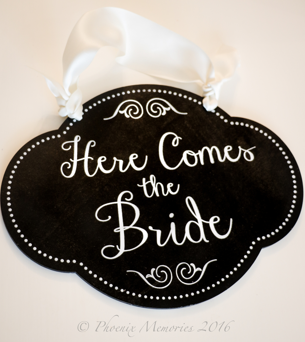 Brides are beginning to see that details such as a hand-painted sign for the ring bearer to carry down the aisle, are just as meaningful and special.
