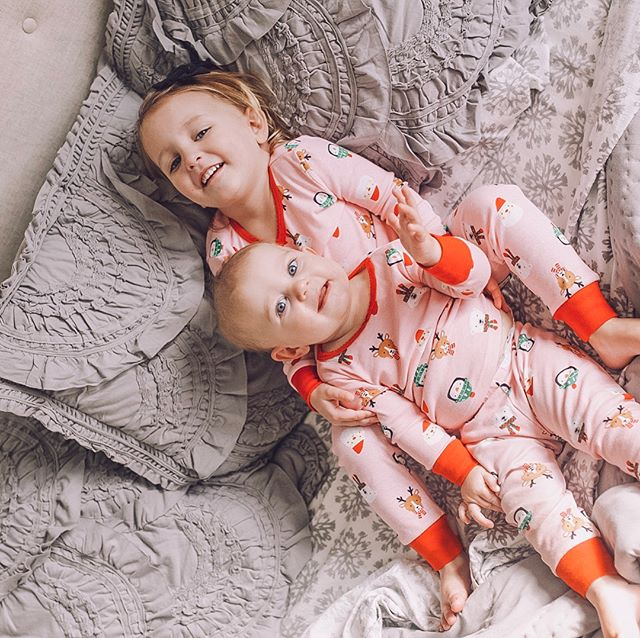 """Lucy said, """"Let me hold the baby!"""" I'm glad someone else is on board with the notion that Anna is still a baby! ❤️ She hasn't requested this (or called Anna a baby) since Anna was... a lot smaller than she is now, and not wiggly 🤣 but I'll take it 😍😍😍 #sisters #gooseandtiny"""